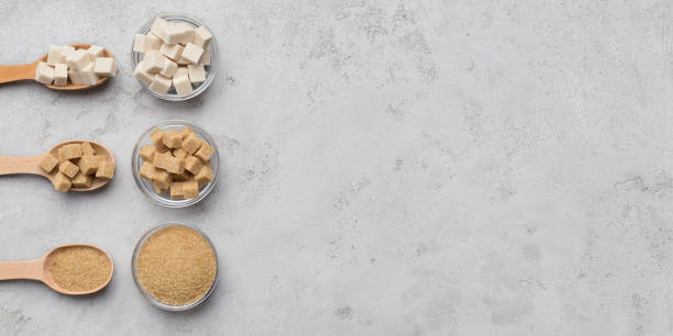 Collection of different kinds of sugar on gray background Various sugars on gray concrete background, top view, panorama, copy space sugar cane stock pictures, royalty-free photos & images