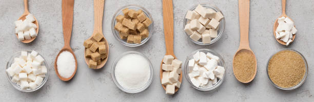collection of different kinds of sugar on gray background - sweeteners stock photos and pictures