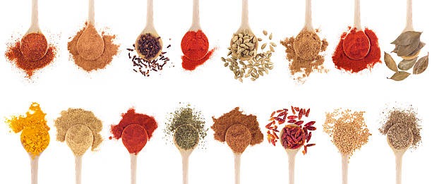 A collection of different spices on wooden spoons collection of 16 spices on wooden spoons (cumin, coriander, cloves, curry, chili, piri piri, cinnamon, cardamom, fenugreek, garam masala, oregano, parsley, paprika, turmeric, bay) isolated on white  garam masala stock pictures, royalty-free photos & images