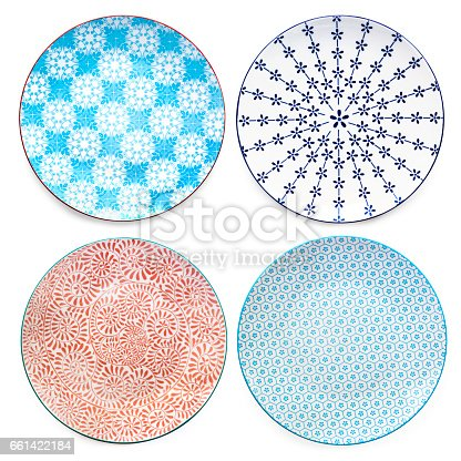 Collection of empty colorful plates.  Top view, isolated on white.  Variety of patterns.