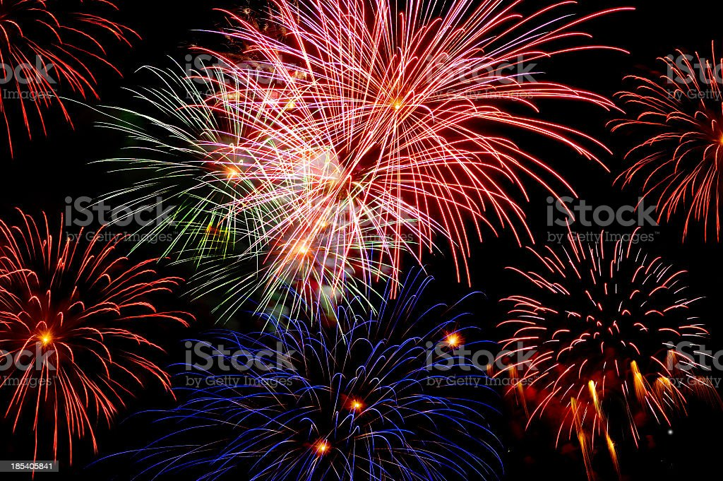 Collection of fireworks exploding in red, pink and blue royalty-free stock photo