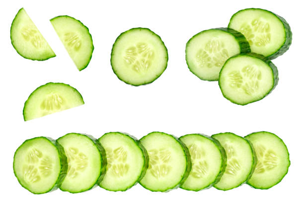 Collection of fresh green cucumbers isolated on white background. Set of multiple images. Part of series stock photo