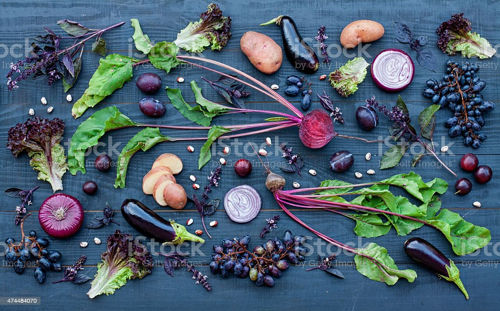 Collection of fresh purple fruit and vegetables stock photo