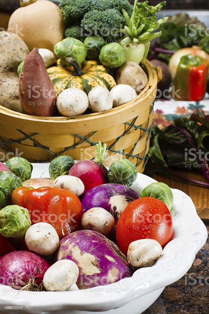 Collection of fresh vegetables in a decorative bowl and basket royalty-free stock photo