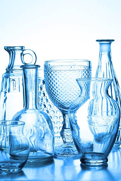 Collection of glass vases backlit with blue tone. stock photo