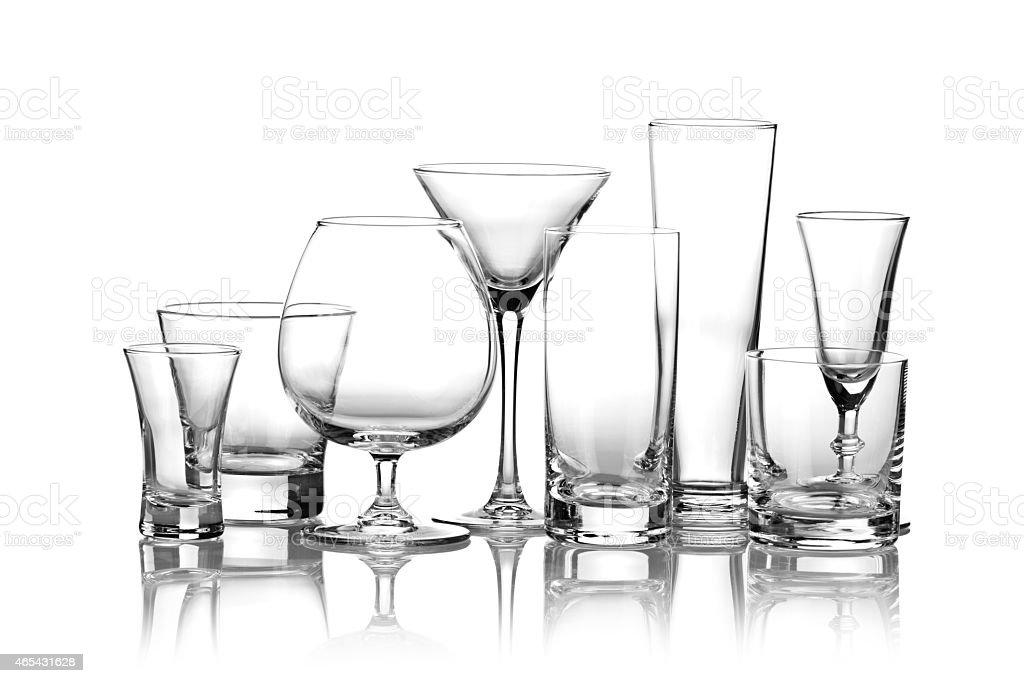 Collection of glasses used for alcoholic drinks on white backdrop stock photo