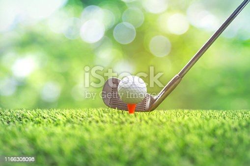 istock Collection of golf equipment resting on green grass. 1166308098