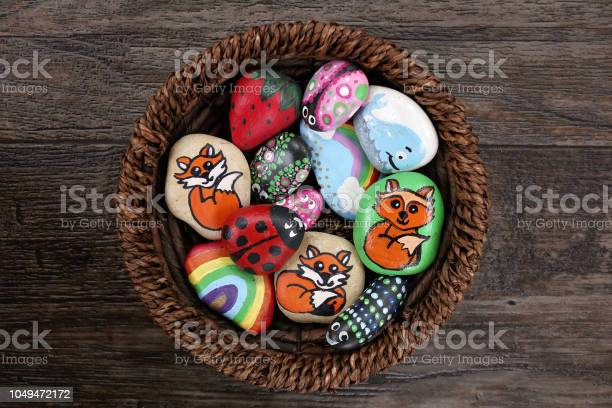 Collection of hand painted colorful cartoon rocks in w wicker basket picture id1049472172?b=1&k=6&m=1049472172&s=612x612&h=oadgscidvlliqxooinjetfpebrqgrhif3enn 1f0wfs=