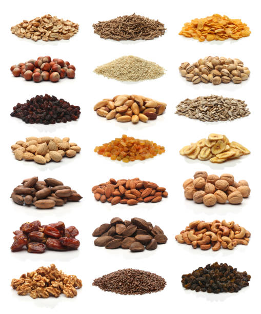 Collection of healthy dried fruits, cereals, seeds and nuts isolated. stock photo