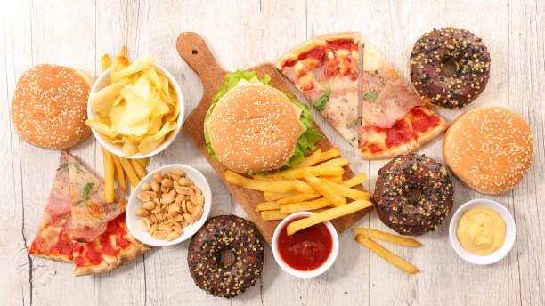 collection of junk food collection of junk food unhealthy eating stock pictures, royalty-free photos & images