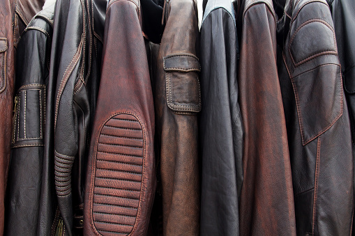 istock Collection of leather jackets on hangers in the shop 612508698