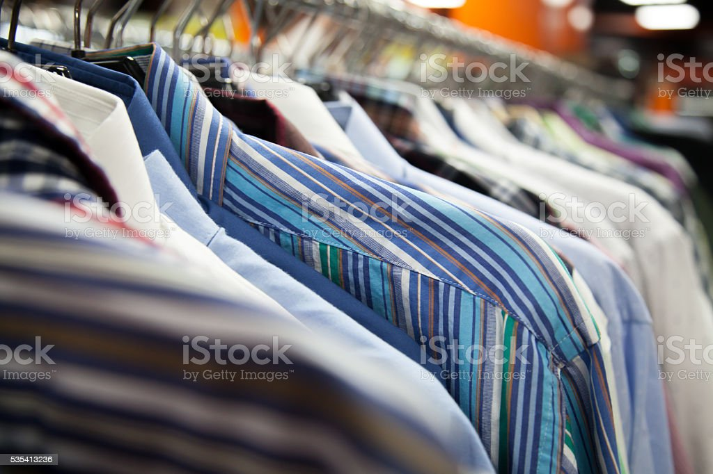 Collection of male shirts on rack stock photo