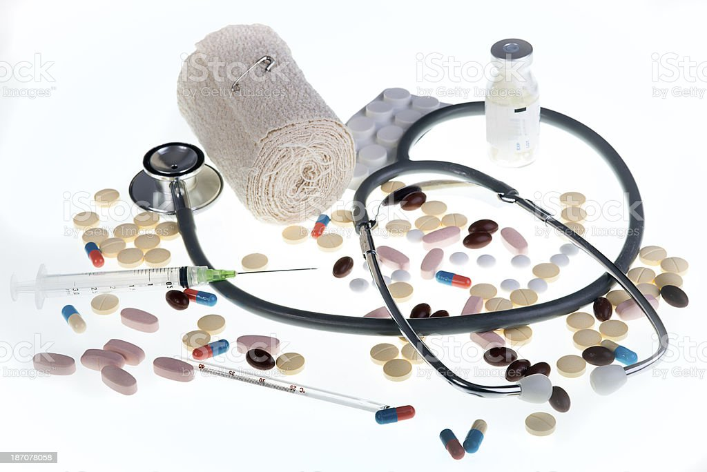 Collection of Medical items including Stethoscope Pills Syringe Thermometer Bandage royalty-free stock photo