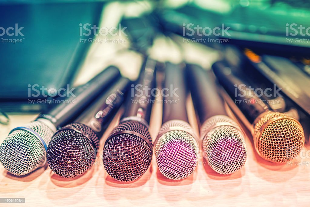 collection of microphones and dj equipement at a concert stock photo