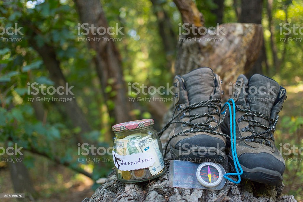 Collection of money in a glass jar for adventure. royalty-free stock photo