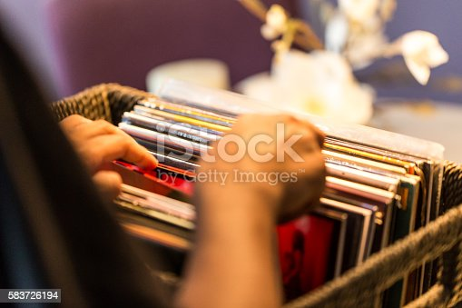 Man searching for a record to play from his collection.