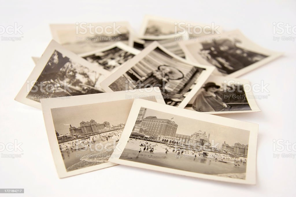 """Collection of old black and white photographs """"Pile of old photographs, selective focus.Similar image:"""" Antique Stock Photo"""