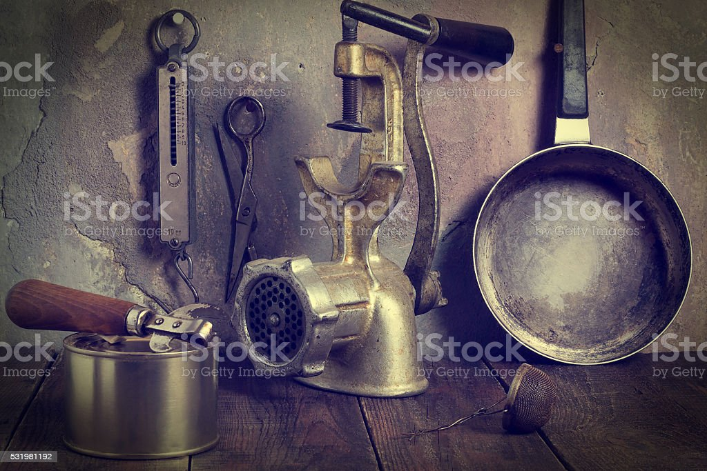 Collection of old kitchen utensils. Tinted Photos stock photo