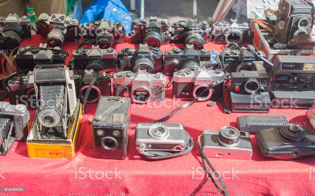 Collection of old vintage cameras at the flea market stock photo