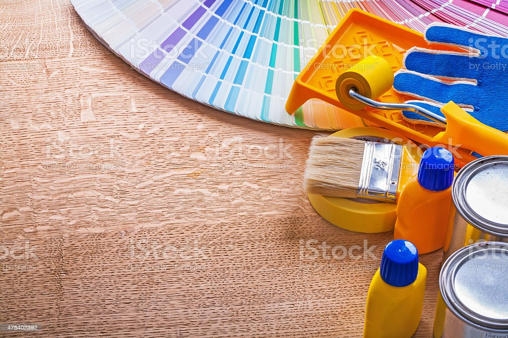Collection of paint tools and pantone color palette guide on stock photo
