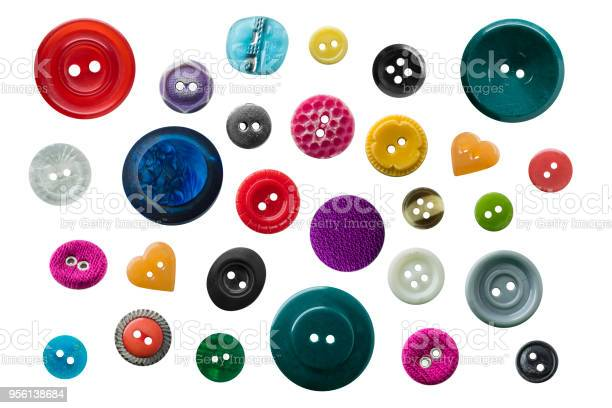 Collection of photographed buttons in different sizes and colors on a picture id956138684?b=1&k=6&m=956138684&s=612x612&h=fw9s uwubto3gojinktct6p312 9opyqr6tioeyb7vk=
