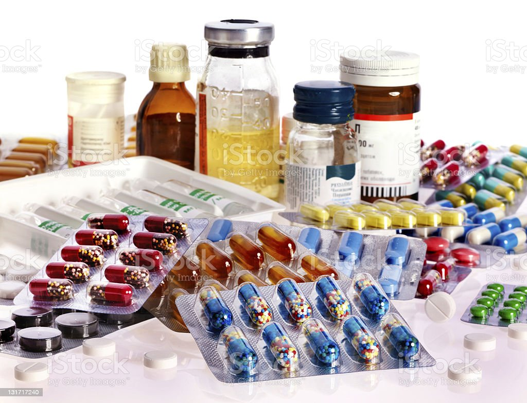 A collection of pills in blister packs and bottles stock photo