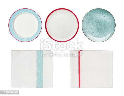 Collection of plates and kitchen towels isolated on white background