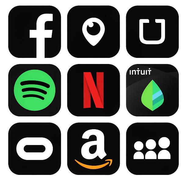 Collection of popular black social media, business logo icons Kiev, Ukraine - October 28, 2016: Collection of popular black social media, travel, business, shopping logo icons printed on paper: Facebook, Periscope, Uber, Amazon, MySpace, Netflix, Intuit and others netflix stock pictures, royalty-free photos & images
