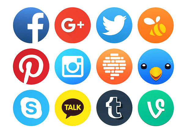 Collection of popular round social networking icons printed on paper stock photo