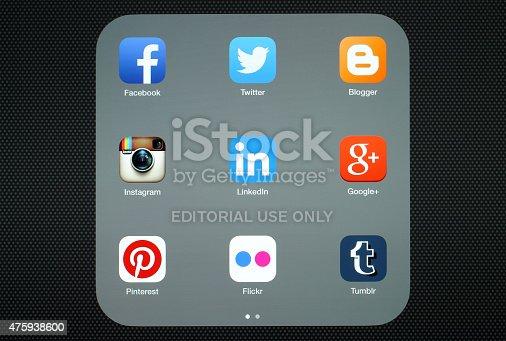 istock Collection of popular social media logos on iPad screen 475938600