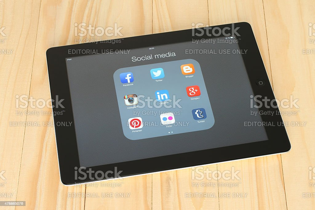 Collection of popular social media logos on iPad screen stock photo