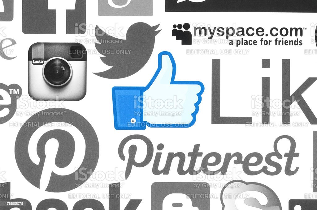 Collection of popular social media logos printed on paper stock photo