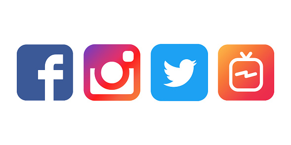 Collection Of Popular Social Media Logos Printed On White Paper Facebook Instagram Twitter And Igtv Stock Photo - Download Image Now