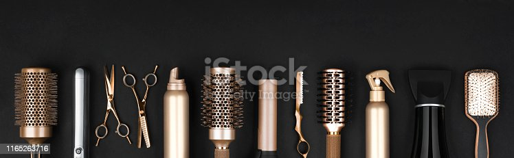 istock Collection of professional hair dresser tools arranged on dark background 1165263716