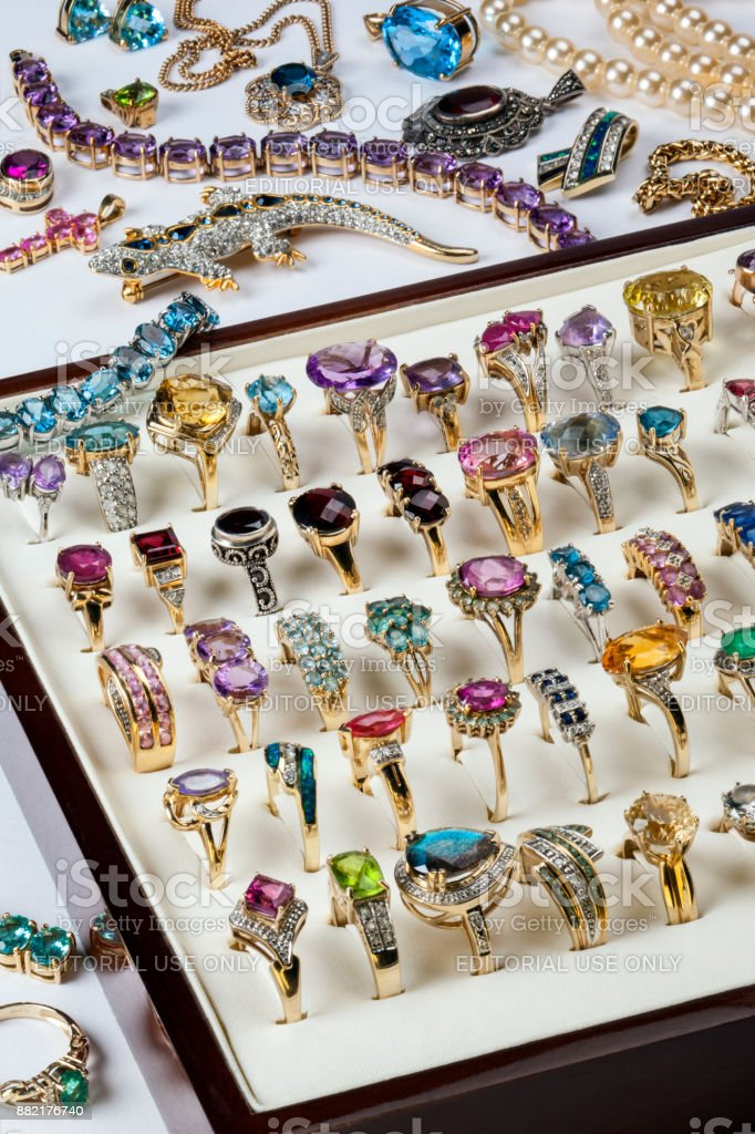 Collection of rings and other jewelry stock photo