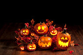 A group of Jack-o-lanterns lit up for the holiday.