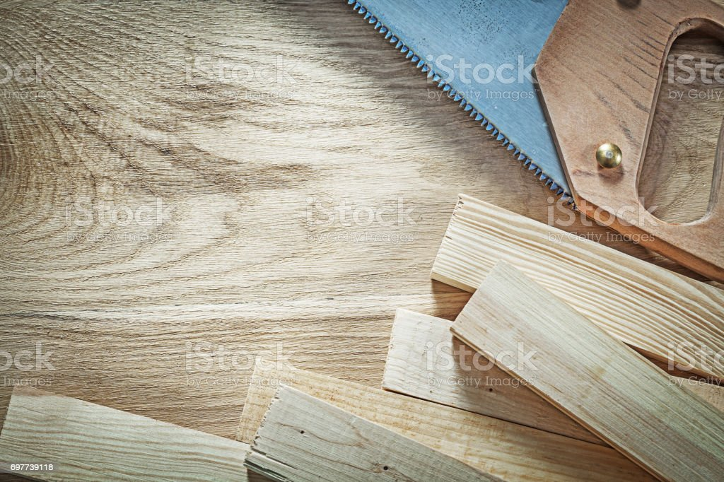 Collection Of Sharp Handsaw Wooden Planks On Wood Board Construc Royalty Free Stock Photo