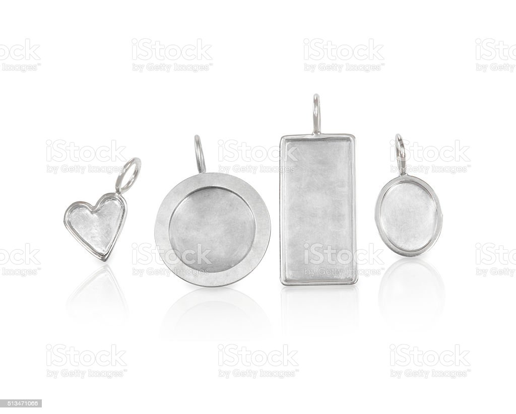 Collection of Silver Necklace Charms in various shapes and sizes stock photo