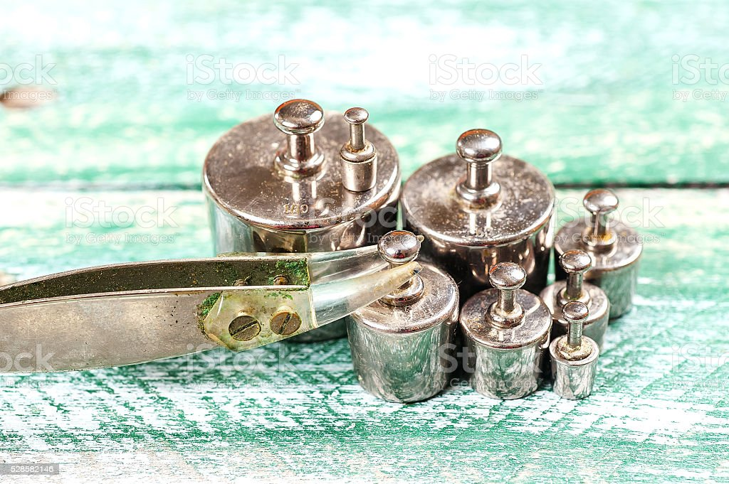 Collection of Small Vintage Iron Calibration Weights stock photo