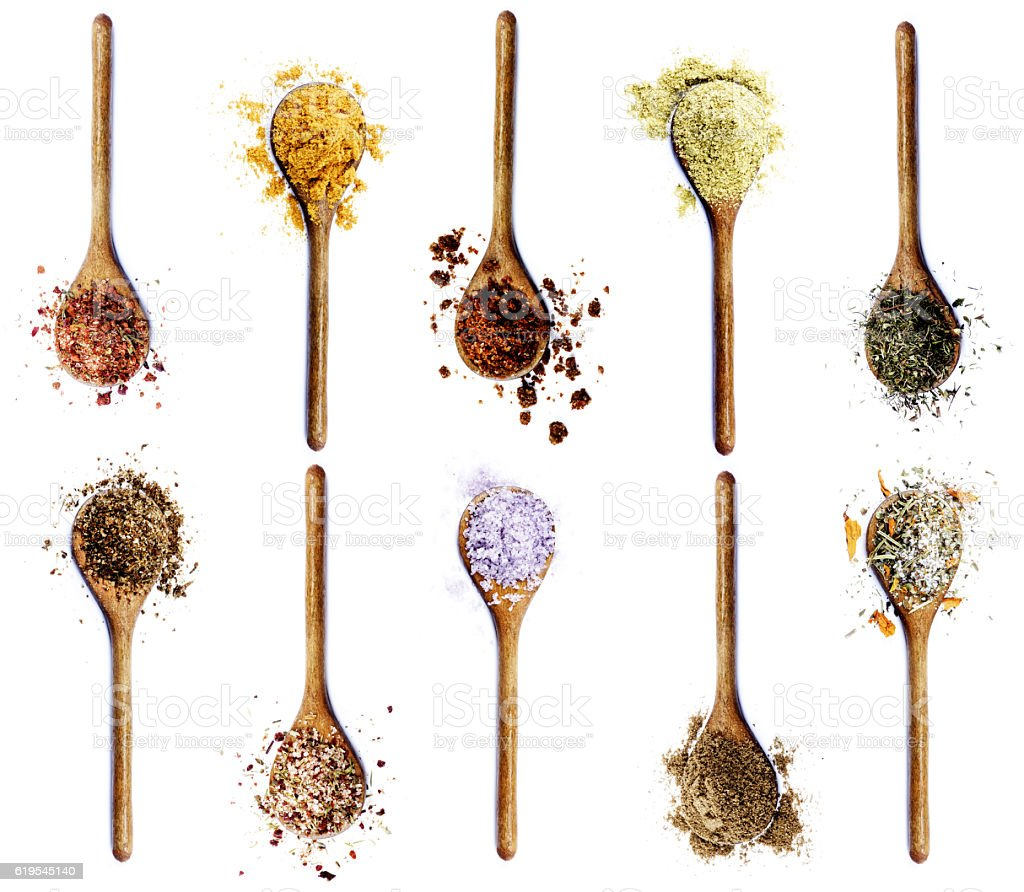 Collection of Spices in Wooden Spoons stock photo