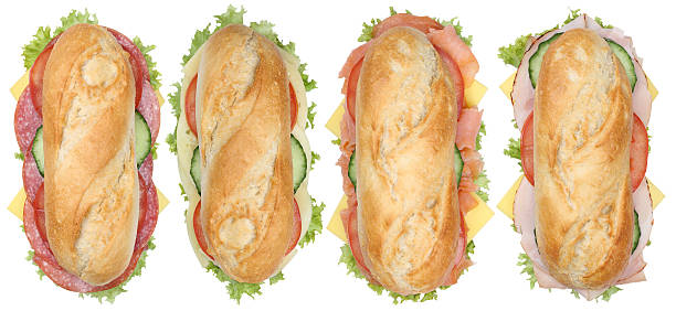Collection of sub sandwiches baguettes with salami, ham and cheese Collection of sub sandwiches baguettes with salami, ham and cheese top view isolated on a white background submarine sandwich stock pictures, royalty-free photos & images