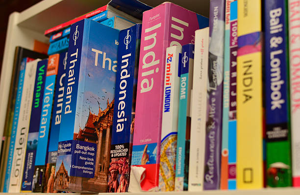 Collection of travel guide books stock photo