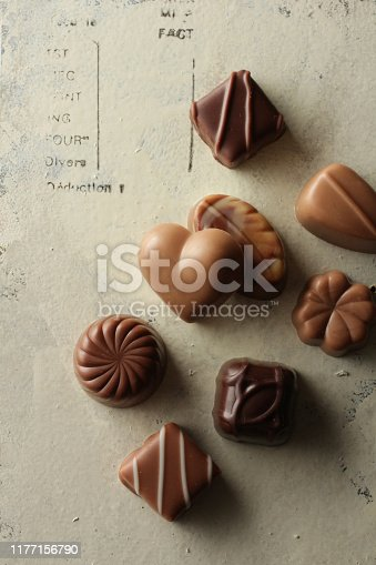 Red chocolate with heart in various chocolates