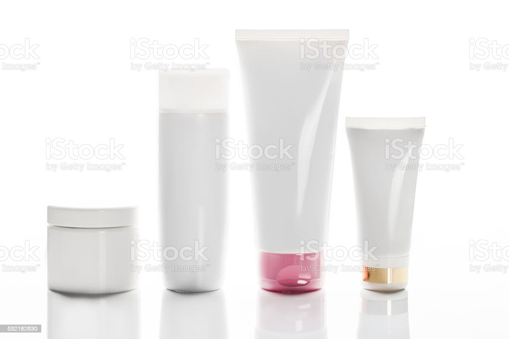 collection of various beauty hygiene containers on white backgro stock photo