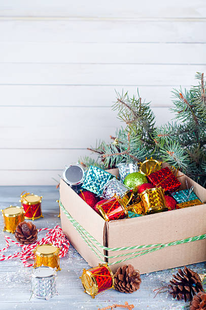 collection of various christmas decorations placed into cardboard box stock photo 623111188 istock - Cardboard Christmas Decorations