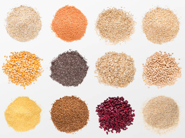 collection of various grains and cereals on white background - riso cereale foto e immagini stock