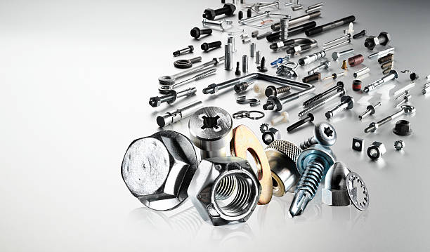 Collection of various hardware fasteners  A shiny collection of hardware, nuts and bolts and fasteners. bolt fastener stock pictures, royalty-free photos & images