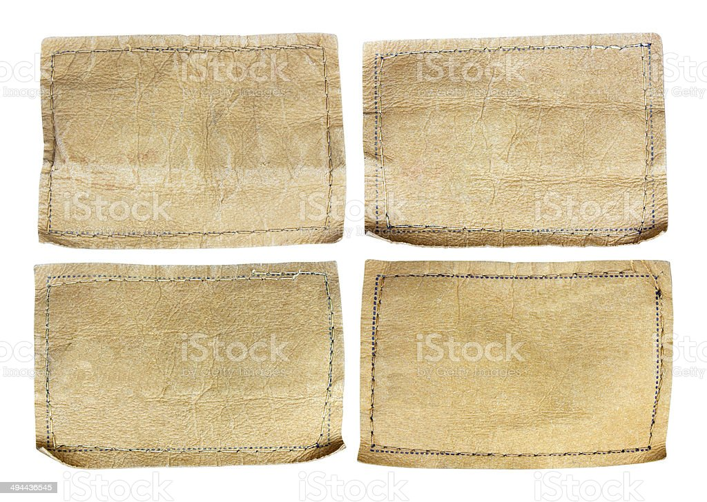 collection of various jeans labels on white background stock photo