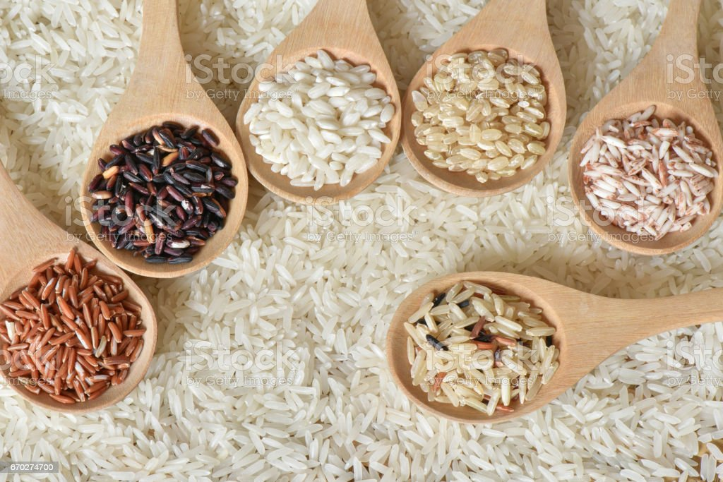 Collection of various rice organic on wooden spoon stock photo