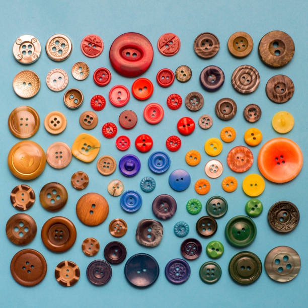 Collection of various sewing button on blue background stock photo